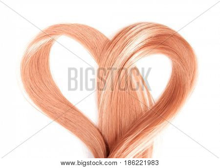 Strawberry blonde hair on white background