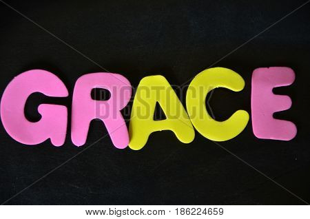 word grace on a  abstract black background