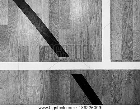 Black Lines In Hall Playground. Worn Out Wooden Floor Of Sports Hall With Marking Lines
