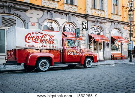 Prague, Czech Republic - May 7, 2017: An old renovated 1930 - 1940s  Coca-Cola red delivery pickup truck 1934 Ford parking on the Prague street  in Prague, Czech Republic