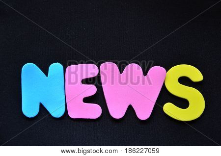 word news on a  abstract black background