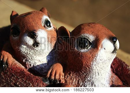 two amusing statuettes of squirrels for a country estate