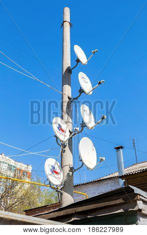 Samara Russia - May 1 2017: Satellite dishes mounted on a pole against the blue sky