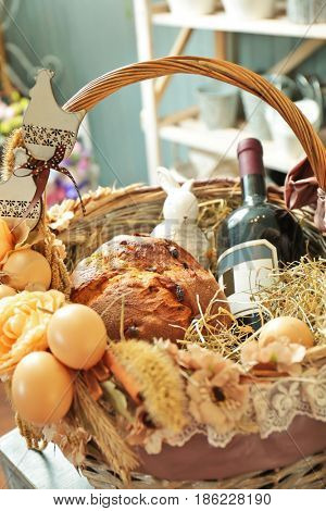Beautiful Easter wicker basket with products, closeup