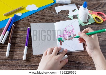 The Child Draws Details. The Child Creates A Note Pad Handmade Applique Decorated Balloon, Craft Pap