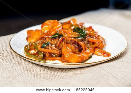 wok fried pork stir fry with sweet peppers and chinese vegetables