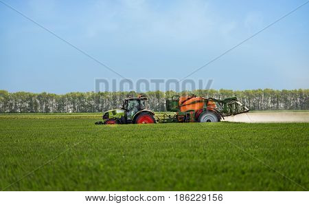 Varna Bulgaria - May 13 2017: Cllas tractor in field. Claas Corporation is a Germany heavy equipment manufacturer with an array of products such as tractors and agricultural equipment.