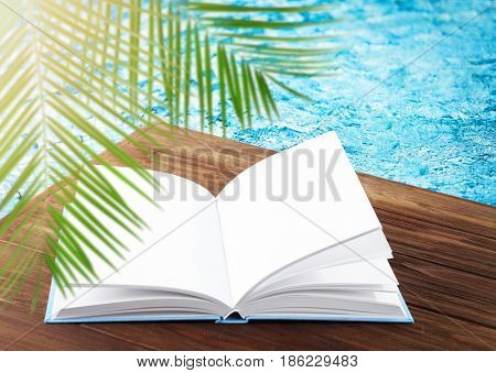 Reading during summer vacation. Book on wooden pier near water