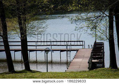 A Tranquil Bridge Over A Beautiful Clean Lake. Spring Season.