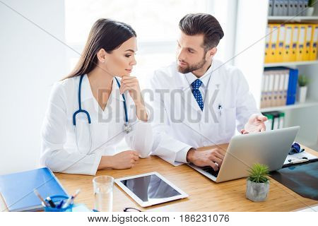 Photo Of Two Doctors Together Discussing New Way Of Treatment While Having A Meeting At Office
