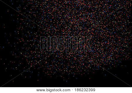 Colorful explosion of confetti. Grainy abstract multicolored texture isolated on black background. Flat design element. Vector illustrationeps 10.