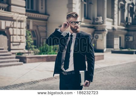 Nerdy Bearded Business Man With Tablet Outside On A Sunny Day. He Is So Harsh! Wearing Suit And Glas