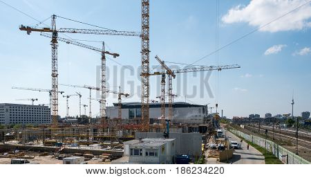 Cranes And Construction Workers Onconstruction Site