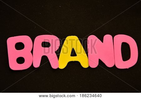 word brand on a  abstract black background