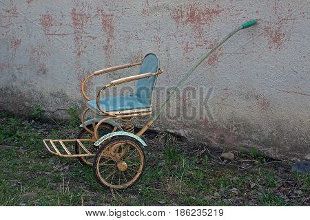 Old-fashioned soviet stroller with two wheels and one handle