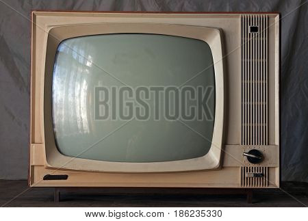 Old soviet retro TV on a gray background