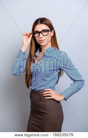 Success Concept. Portrait Of Serious Young Business Lady In Glasses And Formal Wear, Standing At The