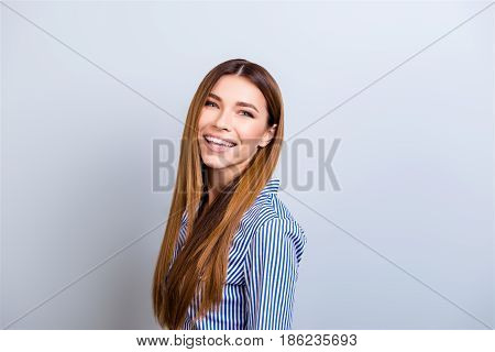 Portrait Of Beautiful Smiling Young Business Lady In Formal Wear Standing On The Pure Background