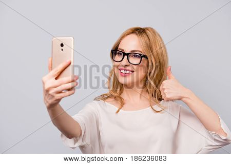 Pretty Smiling Woman With Blonde Hair In Spectacles Taking Selfie And Showing Thumb-up
