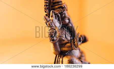 Close-up Of Metal Statues Of Lord Ganesha Of Hinduism. Hinduism And Its Gods. Macro Photo Of Ganesha