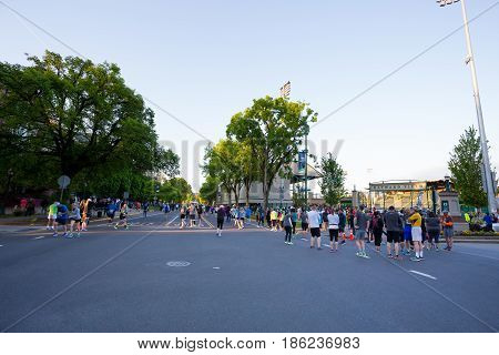 EUGENE, OR - MAY 7, 2017: Runners start to gather near the starting line of the 2017 Eugene Marathon race held on the University of Oregon campus.