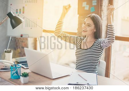 Happy Smiling Woman In Striped Blouse Triumphing After Solving Difficult Task. Intentional Sun Glare
