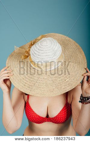 Summer Girl Covers Her Face With Big Hat