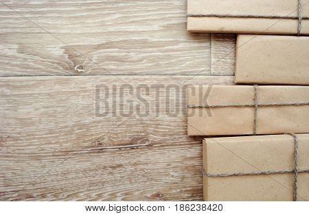 Gift or parcel on a wooden background