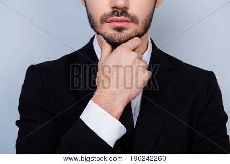 Close Up Photo Of Confident Serious Thoughtful Man In White Shirt And Black Jacket Touching His Chin