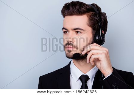 Close Up Portrait Of Concentrated Man In Formalwear Trying To Adjust The Microphone Of His Headphone