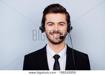 Close Up Photo Of Handsome Young Smiling Confident Worker Of Call Center Isolated On Gray Background