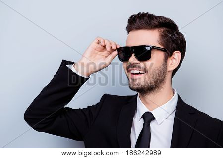 Close Up Portrait Of Handsome Smiling Happy Man In Black Formal-wear And Stylish Hairdo Touching His