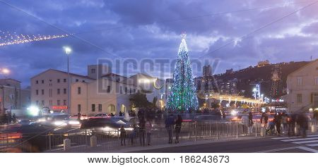 HAIFA, ISRAEL - DECEMBER 10, 2016: The German Colony decorated with symbols of cultures for the winter holidays in Haifa, Israel. German Colony steet is full.