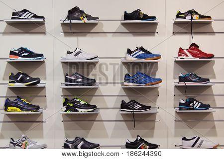 Chernihiv / Ukraine. 04 September 2015: Sneakers on the shelves in the shop. Big assortment of sport footwear. 04 September 2015 in Chernihiv / Ukraine.