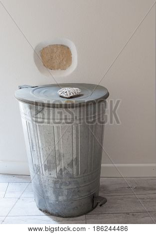 View of aluminum trashcan used how ornament in a house