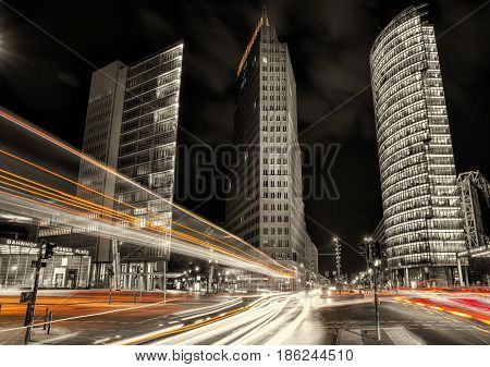 berlin, potsdamer platz at night with traffic lights