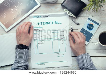Internet bill invoice on the white table.