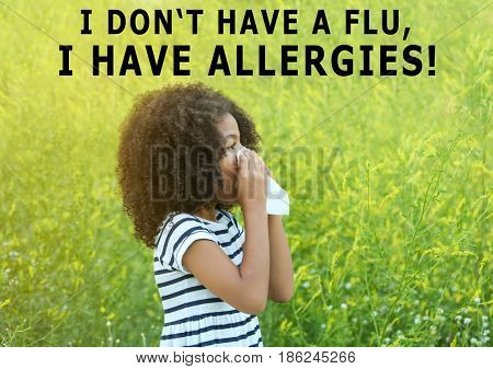 Pollen allergy. Little African-American girl with tissue outdoor