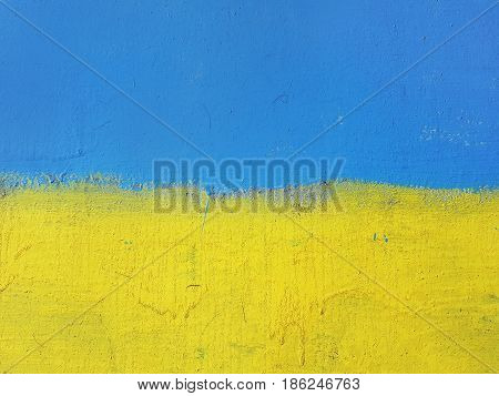 The national state flag of Ukraine: the top is blue the bottom is yellow street art graffiti.
