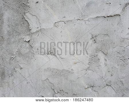 Concrete wall light gray uneven surface bumpy designer modern texture background.
