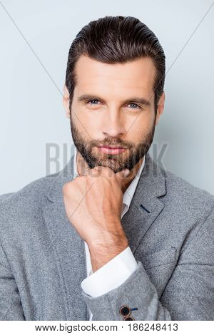 Vertical Close Up Portrait Of Serious Confident Thoughtful Man In Shirt And Jacket Touching His Chin