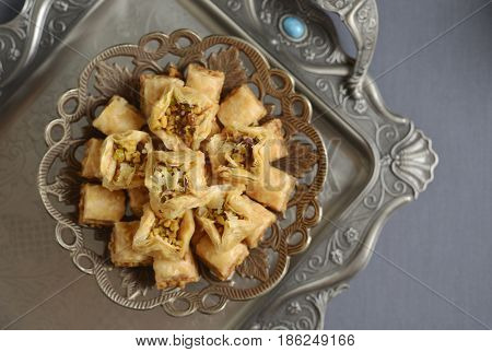 Baklava- a pastry made with layered filo stuffed with chopped nuts and sweetened with sugar syrup or honey. A meditteranean dessert cuisine.