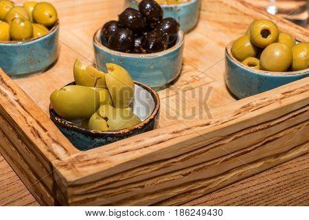 Close-up of green and black olives at restarant