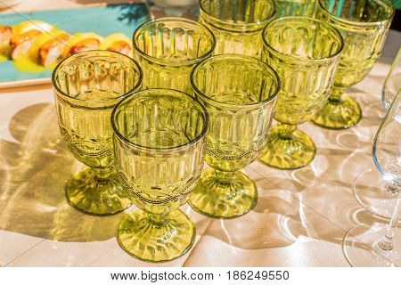 Closeup of emplty wineglasses standing at dinner party or rout