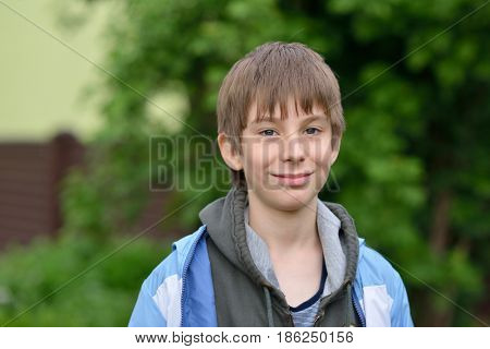 Boy. Outdoor portrait of 11 years old teenager. Handsome young boy. Child's portrait.