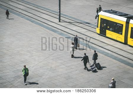 Berlin Germany - may 11 2017: Tramway /tram train /streetcar and people from above outdoors at Alexanderplatz in Berlin Germany