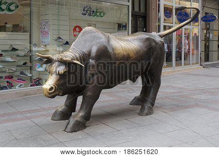 SKOPJE, MACEDONIA - MARCH 9, 2017: bronze sculpture of big bull in Skopje, Macedonia.