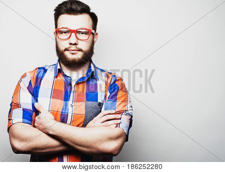 Young bearded hipster man wearing red eyeglasses