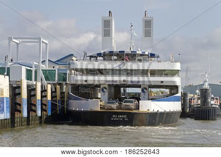 Lewes, Delaware: September 5, 2014 - The Wilmington Ferry docked in Delaware with passengers and vehicles on board. The ferries traverse the Delaware Bay before it meets the Atlantic Ocean.