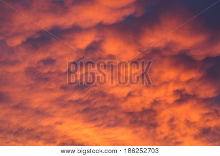 Fiery vivid sunset sky clouds scape background